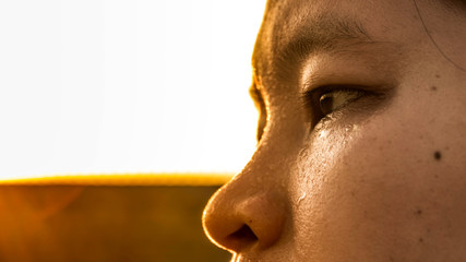 Young sports woman's face sweating from exercise