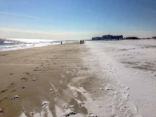 Snow lying on a sandy beach in winter