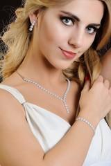 Beautiful belonde girl with luxury jewellery