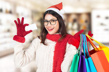 Christmas Shopping woman with a bags for christmas sales over sh