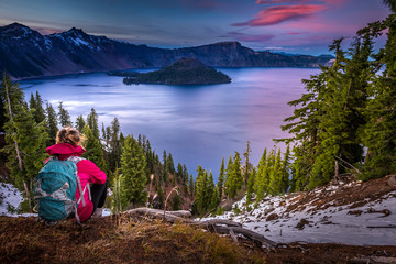 Tourist looking at Crater Lake Oregon Landscape