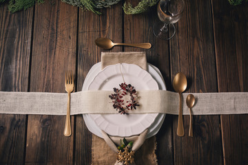 Table Christmas setting with luxurious cutlery