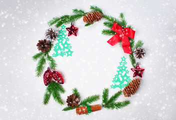 Christmas decoration wreath fir branches cones Christmas balls paper Christmas trees
