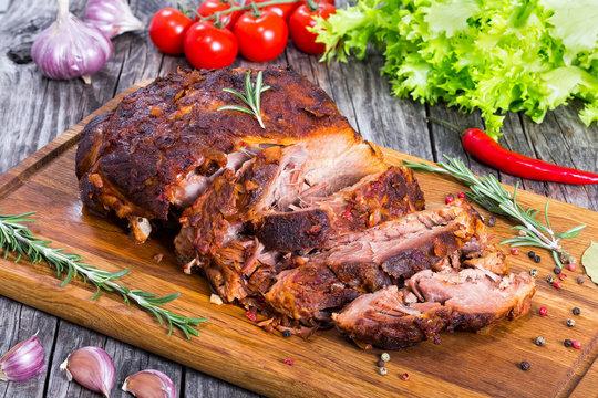 Big Piece of Slow Cooked Oven-Barbecued Pulled Pork shoulder