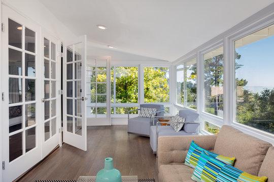 Bright solarium-style sunroom off the master suite.