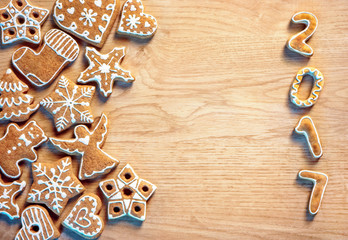 Merry Christmas and Happy new year! Delicious cookies on wooden background. Top view.