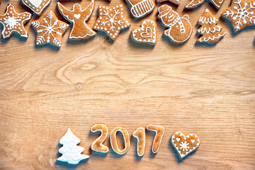 Merry Christmas! Homemade cookies on wooden background. Copy space for your text. Christmas baking concept