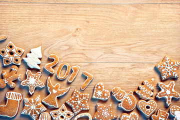 Christmas background with Gingerbread cookies on wooden table. Copy space for your text. Top view