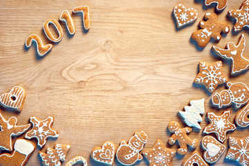 Merry Christmas and Happy new year! Traditional Christmas cookies on wooden table. Top view. Christmas baking concept