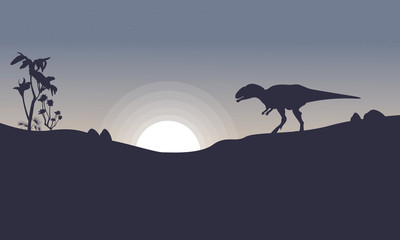 Mapusaurus on the hill scenery of silhouettes