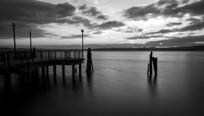 Sunset on Bracciano lake in Italy, long exposure in black and wh