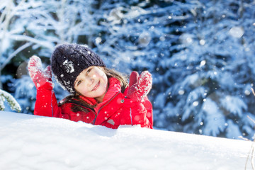Happy little girl in snow. Nice winter time
