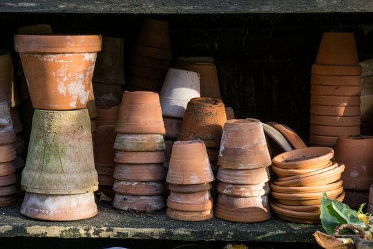 rustic vintage stacks of terracotta flower pots