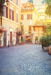 typical italian street in Trastevere with sunshine, Rome, Italy
