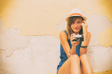 Hipster girl with old camera.
