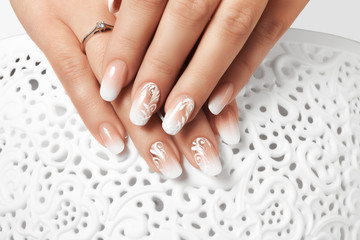 White drawing female nails.