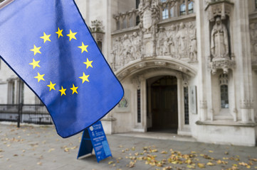 European Union flag flying in front of The Supreme Court of the United Kingdom in the public Middlesex Guildhall building in Parliament Square in London