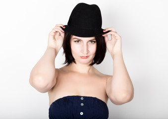 Closeup portrait of beautiful sexy young woman in black hat, posing