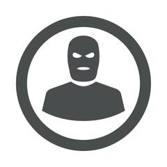 Icono plano silueta terrorista en circulo color gris