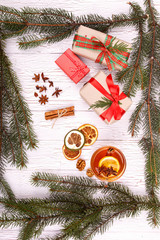 dried lemons,gift boxes and spruce twigs lying on white floor