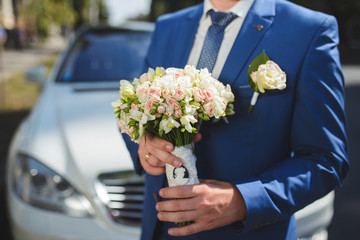 Groom with Bouquet at Car