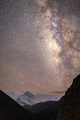 Beautiful Himalayan mountain landscape with milky way and shooting star, Annapurna region, Nepal