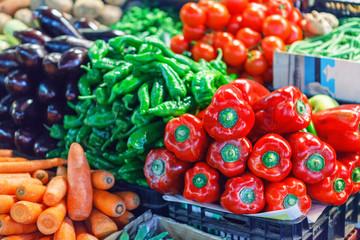 Fresh ripe vegetables on shelves in market