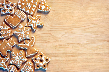 Homemade Christmas cookies on wooden background. Copy space for your text. Top view