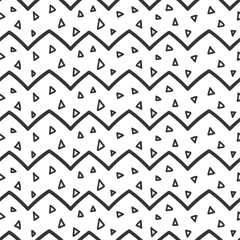 Hand drawn seamless pattern with triangle confetti and zigzags