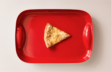 Pizza cut on red tray