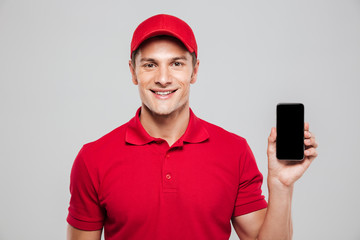 Smiling courier with phone