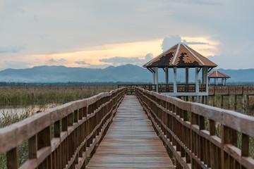 Sunset long wooden bridge in Sam Roi Yot National Park ,Prachuap