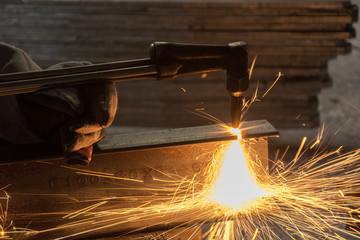 Worker metal Cutting With acetylene welding cutting torch