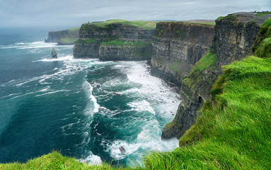 Wall Murals Europa Spectacular view of famous Cliffs of Moher and wild Atlantic Ocean, County Clare, Ireland.