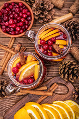 Homemade mulled wine with orange slices, cranberries, cinnamon .