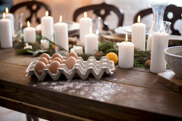 Eggs on the table with candles