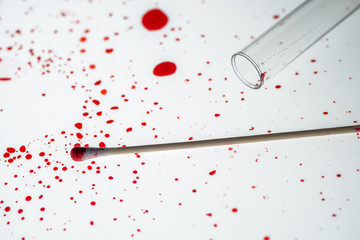Cotton swab and blood drips in crime scene investigation