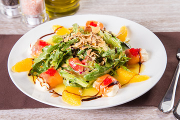 salad with red fish and orange