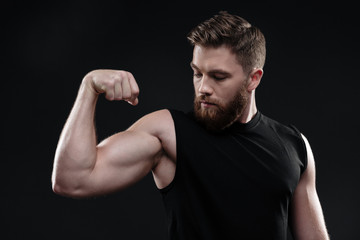 Fitness man demonstrates bicep