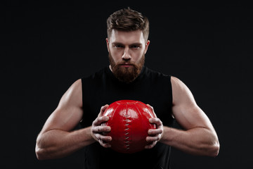 Serious trainer with ball