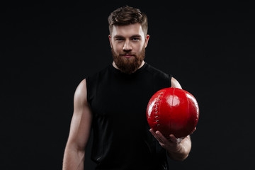 Smiling trainer with ball in hand