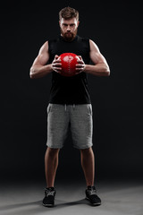 Full length image of trainer with ball