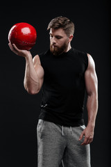 Image of young trainer holding ball
