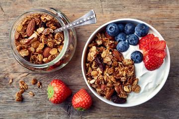 Homemade granola with yogurt and fresh berries