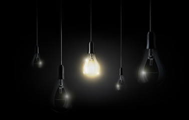 Glowing light bulb is hanging between a lot of turned off light bulbs on dark black background, copyspace, transparent vector
