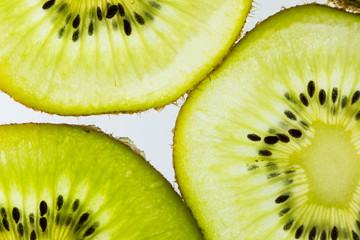 Soft focus,Abstract background with silhouette citrus-fruit of orange and kiwi slices. Close-up. Studio photography.