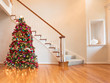 Colorfully decorated Christmas in home on wooden oak floor