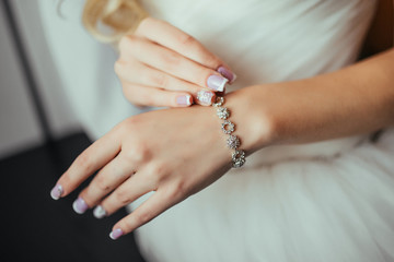Wedding. Wedding day. Luxury bracelet on the bride's hand close-up Hands of the bride before wedding. Wedding accessories. Selective focus.