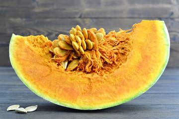 Pumpkin slice on wooden background