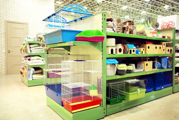 Different animal goods on pet shop shelves